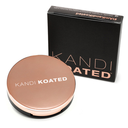 A view of a closed round rose-gold compact with the Kandi Koated logo on the lid beside its black and rose gold box.