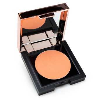 "A small black square compact with a rose gold lid containing a mirror sits open, revealing a circle of warm, peachy coral powder Chic to Chic blush in ""Making Me Blush."""