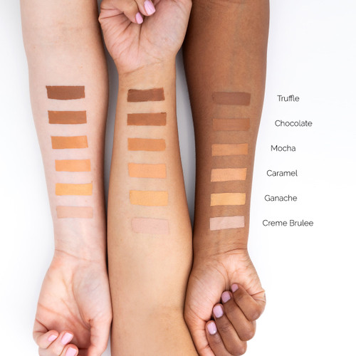 An image of three outstretched arms of differing skin tones showcasing different colors of Finesse concealer in swatches on each arm for comparison.