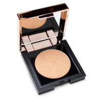 "A small square black and rose gold compact with a mirrored inner lid is open to reveal a round of illuminating powder in ""Climax"", a shimmering light warm gold."